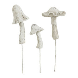 Cement Garden Mushrooms - Mushrooms get a bad rap being called fungus and all. But these decorative cement garden conversation pieces will solicit nothing but complements. Their stands are made of iron. Heights are staggered. Group together or scatter throughout your garden.