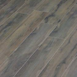 Porcelain Wood Tile - Cashew Porcelain Tiles from the Botanica Series have the distinctive grain of wood in rich browns. These tiles are recommended for light commercial use and for all residential design projects including walls, countertops and floors,
