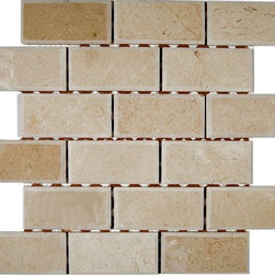 """GlassTileStore - Crema Marfil 2x4 Beveled Stone Tile - CREMA MARFIL 2X4 BEVELED MARBLE TILE  This creama marfil beveled tile can make any room look contemporary to classic. The mesh backing not only simplifies instalaltion, it also allows the tiles to be separated which adds to their design flexibility.      Chip Size: 2x4 Beveled Edge Brick   Color: Crema Marfil   Material: Marble   Finish: Polish   Sold by the Sheet - each sheet measures 12"""" x 12"""" (1 sq. ft.)   Thickness: 8mm    - Glass Tile -"""