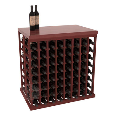 Double Deep Tasting Table Wine Rack Kit + Butcher Block Top in Redwood with Cher - The quintessential wine cellar island; this wooden wine rack is a perfect way to create discrete wine storage in open floor space. Includes a culinary grade Butcher's Block top. With an emphasis on customization, install LEDs to create an intimate wine tasting setting. We build this rack to our industry leading standards and your satisfaction is guaranteed.