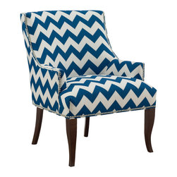 CR Laine - Tumnus Chair - The Tumnus chair invites regal sophistication to the transitional space. Atop exposed legs, the seat's refined silhouette shines with metallic nailhead trim. Shown in Limitless Indigo; Available in a variety of fabric and finish options; Customizable nailhead trim; Hand crafted in the USA using sustainable materials; Kiln-dried frames made from responsibly harvested hardwood; Water-based wood adhesive with no VOC emissions; Seat deck and trim pad made from 80% regenerated fibers; Cushion cores made from at least 10% natural plant-based ingredients