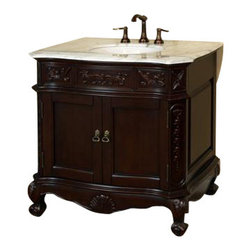 "Bellaterra Home - 34.6 Inch Single Sink Vanity-Wood-Walnut-Carrera White Marble - Give your bathroom an upscale appearance with this handcrafted bathroom vanity, featuring smooth, rich finishes and a lustrous construction of wood. This bathroom cabinet will enhance your traditional bath decor with antique-style and classical appeal. Features intricate acanthus leaf details and scrolled feet. A beautiful 3/4"" thick hand-polished marble top completes the look. Vanity dimension: 34.6 W x 23.6 D x 36 H"