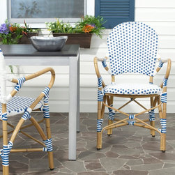 Safavieh - Safavieh Hooper Dining Chair - Set of 2 - FOX5209A-SET2 - Shop for Chairs and Sofas from Hayneedle.com! East meets West in the Safavieh Hooper Dining Chair - Set of 2. These beautiful dining chairs embrace a European-inspired style that is fused with elements from Asia and the Pacific Islands. The vibrant contrast of the wicker colors and the bamboo-styled aluminum frame take their cue from cultural elements and pieces and materials first popularized in Asia while this traditional bistro form nods to Western influences as well. The result is a harmonious transitional piece that is at once eye-catching and easily integrated into almost any setting or decor.About SafaviehConsidered the authority on fine quality craftsmanship and style since their inception in 1914 Safavieh is most successful in the home furnishings industry thanks to their talent for combining high tech with high touch. For four generations the family behind the Safavieh brand has dedicated its talents and resources to providing uncompromising quality. They hold the durability beauty and artistry of their handmade rugs well-crafted furniture and decorative accents in the highest regard. That's why they focus their efforts on developing the highest quality products to suit the broadest range of budgets. Their mission is perpetuate the interior furnishings craft and lead with innovation while preserving centuries-old traditions in categories from antique reproductions to fashion-forward contemporary trends.
