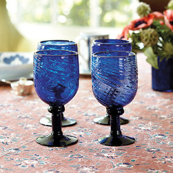 Ballard Designs - Bunny Williams Cobalt Goblets - Set of 4 - Mix with Bunny's Spiral Glassware. Made of blown recycled glass. Rather than matching the rest of her glasses, Bunny Williams likes to use large colored ones for water and tie the color into her dinnerware or table linens. She designed these substantial, turned stem Goblets to pair with her classic blue and white Campbell House Dinnerware. The deep swirled bowl with thick walls feels good in your hand.Bunny Williams Cobalt Goblet features: . .