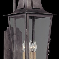 Troy Lighting - Troy Lighting French Quarter Transitional Outdoor Wall Sconce X-3692B - The Troy Lighting French Quarter Transitional Outdoor Wall Sconce features old world material and finish mixed with modern style in a chic outdoor wall light fixture.  The hand-forged iron gives a nod to the craftsmanship of the French Quarter while the sleek rectangle of the lantern feels more modern. Aged pewter gives this outdoor wall light a weathered look.