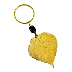 Aspen Wine Charm in 24-karat Gold - Your wine will sing, sing-a-ling-a when it's wearing baubles, bangles and beads around its neck. This hand-crafted charm features a brass ring big enough to fit around a napkin or wine bottle, a glass bead and a real aspen leaf coated in your choice of iridescent or 24-karat gold.