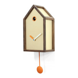 Progetti - Mr. Orange 2190 Gold Wall Clock - Wall cuckoo clock with the classical form, already known and appreciated, to which we are attached: the cottage. Here, however, the lines are clean, simple, the structure is reduced to the essence. Mr. Orange is realized by a solid walnut grid with reduced section that defines a number of areas filled with different patterns. As a painting, the structure acts as a frame. You can choose between different textures to give the preferred form to Mr. Orange and match the style of your home. In addition to the wooden frame, the common feature that distinguishes every clock is the orange color. Battery quartz movement. The Cuckoo strike is switched off automatically during the night controlled by a light sensor.