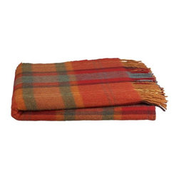 Aidan Throw | Crate&Barrel - When you're trying to change up the look of a room, one of the easiest and least expensive things to do is add a throw blanket. This sumptuous plaid Irish throw may just inspire you to switch out your pillow covers and rug as well, giving a room an instant makeover on a small budget.
