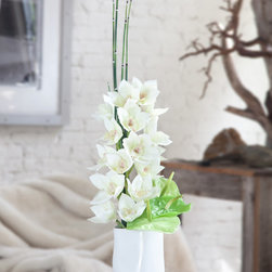 Silk Orchid Arrangement Clarity - Impressive white silk Cymbidium orchid is set in white ceramic vase and decorated with 3 Anthurium silk flowers and green bamboo. This arrangement delivers elegance to any space.