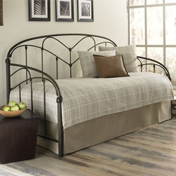 Pomona Daybed - The transitional styling of the Pomona metal daybed suits many different bedroom designs. Fluted posts supporting arching cross rails and long spindles with subtle floral castings are all finished in a warm, earthy Hazelnut.