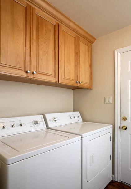 Traditional Laundry Room by Precision Cabinets