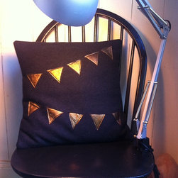 Wool & Italian Leather Bunting Cushion by Imagine Lovely - I can't think of a party garland that I don't love. This pillow features a gold leather bunting pattern that's simple, graphic and fun.