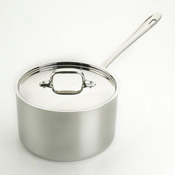 All-Clad - Stainless Steel Saucepan with Lid - Make sauces and reheat food with the All-Clad Saucepan. The smaller surface area and tall, straight sides allow it hold heat, while the lid limits evaporation. This pan is constructed with bonded stainless steel for exceptional heating. Features: -Lid controls evaporation.-Signature stay-cool handles are cast from solid stainless-steel and designed for ergonomic comfort.-Made in the USA.-Dishwasher safe.-Stainless collection.-Convenient capacity marking on the bottom.-Collection: Stainless.-Distressed: No.-Powder Coated Finish: No.-Gloss Finish: No.-Material: Stainless Steel; Aluminum.-Base Material: Stainless Steel.-Hardware Material: Stainless steel.-Product Type: Sauce Pan.-Shape: Round.-Non Toxic: Yes.-Scratch Resistant: No.-Rust Resistant: No.-Warp Resistant: No.-Chip Resistant: No.-Tarnish Resistant: No.-Stain Resistant: No.-Peel Resistant: No.-Nonreactive: Yes.-Non-Stick Surface: No.-Construction: 3-ply.-Rounded Base: No.-Oven Safe: Yes.-Microwave Safe: No.-Dishwasher Safe: Yes.-Preseasoned: No.-Maximum Temperature: 800 Degrees.-Stove Type Compatibility: Gas; Induction; Electric; Glass.-Lids Included: Yes -Number of Lids: 1.-Lid Handle: Yes.-Lid Material: Stainless steel.-Lid Finish: Stainless Steel.-Heat Resistant Lids: Not heat resistant.-Air Vents: No..-Handles: Yes -Handle Material: Stainless steel.-Handle Finish: Stainless steel.-Helper Handle: No.-Non-Slip Handle: No.-Heat Resistant Handles: Handles are not heat resistant..-Interior Measuring Scale: No.-Outdoor Use: No.-Pouring Rim: No.-Recommended Utensil Material: Wood; Silicon; Rubber; Plastic; Stainless steel; Aluminum; Copper.-Hanging: Yes.-Commercial Use: Yes.-Recycled Content: No.-Eco-Friendly: No.-Product Care: To avoid warping, never place a hot pan under cold water. Allow pan to cool prior to cleaning. For nonstick surfaces, wash with warm, soapy water after each use. For stainless steel surfaces, we recommend a nonabrasive and non-chlorine stainl