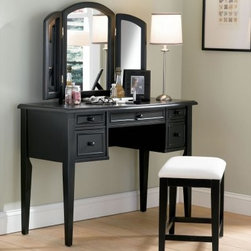 Powell Boulevard Antique Black Bedroom Vanity Set - The charming Powell Boulevard Antique Black Bedroom Vanity Set will add a transitional elegance to your decor. This beautiful dressing table features a hinged tri-fold mirror for a side-to-side view. The make-up vanity top is spacious enough to display prized photos and accessories. Store hairbrushes, make-up, and jewelry in any or all of the five drawers. The square tapered legs provide stability and style while the antique black finish coordinates with any decor. The matching bench is upholstered in neutral beige fabric to blend with any decor and provide hours of comfortable seating. Some assembly required.More About Powell FurnitureBased in Culver City, Calif., the Powell company designs, imports, and distributes occasional, dining, accent, and youth furniture across all style categories. Since 1968, Powell has grown to become one of the most recognized names in the home furniture industry. From sturdy, safe childrens furniture to elegant bedroom and other home collections, Powell continues to develop new and exciting designs for homes around the globe.