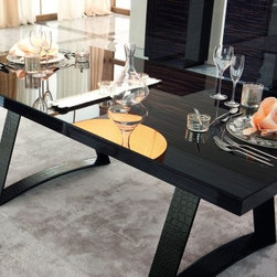 Nightfly Rectangular Dining Table - Ebony - For a dining experience like no other choose the Nightfly Rectangular Dining Table - Ebony. The high-gloss ebony finish gives this piece its rich almost liquid appearance – a quality enhanced by its protective glass top. European craftsmanship runs deep in this table's soul – it comes directly from Italy where it is constructed with the finest of modern materials. The angled support base is upholstered in faux-crocodile Eco-leather letting this piece look sensational while also being environmentally considerate. Make your dining room into an experience like no other with the Nightfly Dining Table. Minimal assembly is required. Rossetto guarantees this product with a one-year manufacturer's warranty. Table dimensions: 79L x 41W x 30H inches. This purchase is for dining table only. About Rossetto USARossetto USA is the U.S. division of the Arros Group a leading manufacturer that exports Italian furniture style and design all over the world. Operating out of its warehouse in High Point N.C. since 1999 Rossetto provides complete contemporary and modern dining bedroom and occasional furniture programs that combine affordable price with innovative Italian design to satisfy the demands of their distinguished customers.