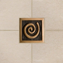 "2"" Solid Bronze Wall Tile with Swirl Design - Burnished Bronze - Add a touch of contemporary style to your kitchen or bathroom with this 2"" swirl design accent tile. It can be installed in different directions for added interest in a pattern."
