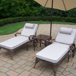 Oakland Living - 4-Pc Outdoor Traditional Chaise Lounge Set - Includes two chaise lounge with cushion, side table and 9 ft. tilting umbrella with stand. Metal hardware. Lightweight. Fade, chip and crack resistant. Warranty: One year limited. Made from rust free cast aluminum. Antique bronze hardened powder coat finish. Minimal assembly required. End table: 17.5 in. W x 17.5 in. D x 19 in. H (15 lbs.). Chaise: 71 in. W x 25.5 in. D x 35 in. H (68 lbs.). Overall weight: 226 lbs.This Chaise lounger set will be a beautiful addition to your patio, balcony or outdoor entertainment area. Our Chaise lounger sets are perfect for any small space, or to accent a larger space. We recommend that the products be covered to protect them when not in use. To preserve the beauty and finish of the metal products, we recommend applying an epoxy clear coat once a year. However, because of the nature of iron it will eventually rust when exposed to the elements. The Oakland Mississippi Collection combines southern style and modern designs giving you a rich addition to any outdoor setting. The traditional lattice pattern and scroll work is crisp and stylish. Each piece is hand cast and finished for the highest quality possible.