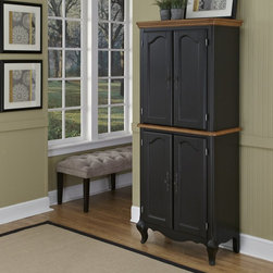 Home Styles - Home Styles The French Countryside Oak and Rubbed Black Pantry - 5519-65 - Shop for Pantries from Hayneedle.com! This Home Styles The French Countryside Oak and Rubbed Black Pantry is ideal for tucking away linens oversized serving pieces or as a traditional food pantry. Rich in French farmhouse style and expertly crafted this pantry is made of hardwood solids oak veneers and engineered wood. A hand-rubbed black finish and distressed oak accents are accented by the decorative brass hardware. Corner peg accents and cabriole legs round out the look. This pantry has two sets of cabinet doors with adjustable shelves behind each. About Home StylesHome Styles is a manufacturer and distributor of RTA (ready to assemble) furniture perfectly suited to today's lifestyles. Blending attractive design with modern functionality their furniture collections span many styles from timeless traditional to cutting-edge contemporary. The great difference between Home Styles and many other RTA furniture manufacturers is that Home Styles pieces feature hardwood construction and quality hardware that stand up to years of use. When shopping for convenient durable items for the home look to Home Styles. You'll appreciate the value.