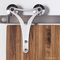 Triangle Barn Door Hardware - Defined by sleek lines, this Triangle Roller Hanger is characterized by its minimalistic shape. A symbol of architectural strength, this Triangle Roller hanger defines modern style. Perfect for use with our Modern Tube Track, Wire Rail Track and Flat Track hardware. This hanger mounts to the face of the door.