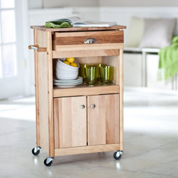 Catskill - The Brennan Microwave Cart Multicolor - 1569 - Shop for Carts from Hayneedle.com! The Brennan Cart offers a handsome style for a serious cook. This item is made from oil-finished natural yellow birch hardwood which is indigenous to the Northeastern U.S. and ranges in color from blond to a darker walnut shade; the natural variation in color allows this cart to coordinate with your existing decor. The Brennan is accented with satin nickel handles cabinet knobs and towel bar. This cart also offers a large utensil drawer and a two-door storage cabinet with adjustable shelves. In addition this microwave cart has a middle shelf that provides an open storage area. This item is equipped with locking caster wheels so you can easily move it from room to room and park it wherever you please.Catskill Craftsmen's Eco-friendly PracticesCatskill Craftsmen is committed to protecting the environment through responsible forest management and manufacturing practices. Located in the Catskill Mountains of upper state New York Catskill Craftsmen plays a role in maintaining the health of the New York City watershed. This watershed provides clean water for New York City and other communities in the area. Healthy well-managed forests are better able to filter pollutants from entering streams and rivers which preserves the quality of watershed resources. With this goal in mind the company supports the efforts of the Watershed Agricultural Council (WAC). With the WAC Catskill Craftsmen encourages lumber suppliers (family forest owners and public land managers) to make wise harvesting decisions and control erosion in order to safeguard water quality.Other efforts to protect the environment include using sustainable wood sources and reducing wood waste. Catskill Craftsmen's manufactured items are made from naturally self-sustaining non-endangered North American hardwoods primarily birch and hard rock maple. All sawdust shavings and waste materials generated during the manufacturing p