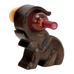 """Benzara - Design Wood Wine Holder with Great Finesse - Impress your guests with this Wood Wine Holder 7""""W, 10""""H when they come to you for a special occasion. Designed with finesse, this wine holder will put you in a class beyond compare. Featuring a contemporary design, this wine holder complements any decor setup with panache. Flaunting a natural wood pattern, this wine bottle holder has a slick brown finish, which enhances its visual appeal. The bottle holder features an elephant silhouette with a curved trunk to hold and display your bottle of wine. With its unique design, this wine bottle holder also doubles up as a charming decor piece. The premium grade wood used to make this wine bottle holder ensures durability and lasting performance with hassle-free maintenance. Your friend who enjoys his wine will be grateful to you if you gift this wine holder..; Contemporary design complements any decor setup; Lasting performance with hassle-free maintenance; Slick brown finish for enhanced visual appeal; Wine bottle holder features an elephant silhouette; Weight: 2.65 lbs; Dimensions:7""""W x 3""""D x 10""""H"""