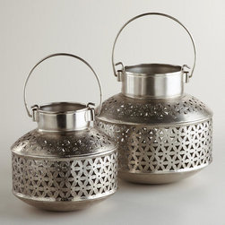 Aluminum Lanterns - These lanterns are made of aluminum and feature a pretty hand-cut geometric pattern. They have a Moroccan style. I'd want to cluster a few together in the living room.