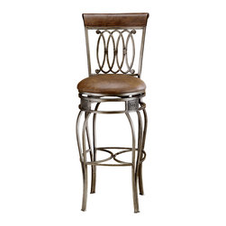 Hillsdale Furniture - Faux Leather Upholstered Wrought Iron Swivel - This attractive stool comes in Bar or Counter seat heights and features an Old Steel frame finish with Brown Faux Leather seats. The elaborate design combined with the elevation of the chair makes for a heavenly sitting experience. Ornamental and elegant, these are stools that will provide an inspiration in any space. Every detail is beautifully defined including the decorative stretchers and swivel base. Handsomely cast with double arched steel rod legs, a comfortably padded seat upholstered in faux leather, its smooth swivel mechanism allows for full rotation. * For residential use. Heavy duty forged steel. Antiqued Old Steel finish. Faux leather upholstery. 360 Swivel mechanism. Cherry finish topped backrestDimensions:. 43H x 20W x 18D (28 in - Seat Height)Drama and style are defined in Hillsdale Furniture's Montello Bar Stool ensemble. Sweeping interlocking circles, intricate complimentary castings and elegantly curved legs combine to create a collection with grace, movement and elegance. Available in both counter and bar heights and with 360 degree swivel. Finished in a dynamic old steel with distressed brown faux leather seats and wood accents.