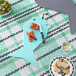 Pic-nic Fish Small Cutting Board - Deliciously different Pic-nic collection sets the unexpected table, full of personality and the merriment of a summer picnic. Top-down silhouette of a fish swims into view as a fanciful board for prepping or serving.