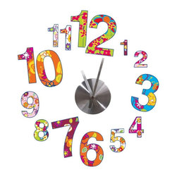 RoomMates - Colorful Clock Wall Clock - This brightly colored combination of wall stickers and a real clock will dress up any room! Great for both kids and adults, these patterned numbers of varying sizes make telling time both easy and fun. Applying the clock is easy: just place the removable and repositionable decals on the wall, then put the clock piece in place in the middle. A great addition to bedrooms, living rooms, dining areas... even classrooms!