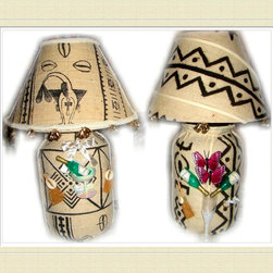 "Wedding Gifts Bride and Groom Undressed Front Lamp Set - TEDDEEZtm Mud cloth Lamps has Bride Lamp dressed in beautiful white dress with pretty gold flowers. The shade has real hair and removable hat with veil. One side is white brocade while the other is white mud cloth. Gold tone bells and fertility pieces accessorize its edges. Undress the base to white mud cloth on one side with black print. Adorned with champagne bottle and glass, brooms, white doves, our wedding day ribbon. Turn it around you have black mud cloth with white stripes. The Groom wears a sharp White three piece suit, and carries cowrie shells and rings in the hands. The shade is white mud cloth, its edges have gold tone bells. The base is white mud cloth with black print on one side and black mud cloth with white stripes on the opposite side. The front has champagne, with burgundy butterflies in the champagne glass. The Brides maids are dressed in darling off white dresses and little matching removable bonnets. Undress each of them to gold, rust and black mud cloth. One side has champagne glass and bottle, rings and brooms. Each shade matches the base. The Groomsmen are rust, gold and black mud cloth. champagne bottle and glass accessorizes one side, including gold tone bell. Each comes with matching shade. Lamps can be displayed in numerous ways. With cloths, with or without hair and veil, without cloths, all white, all black, white top black bottom, black top white bottom. Each lamp Stands 18""h, has a glass base and uses a 60 watt bulb, made in the U.S.A.. The gift that will be talked about for years to come. Comes separately also."
