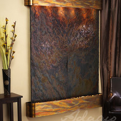 Slate Wall Mounted Water Features - The Majestic River with Rajah Slate - The Majestic River Wall Fountain with Slate Face is breathtaking with any selection of the two available Slate choices. Featuring two large panels, complimented by the rustic powder coated steel, this large wall feature will become the center point of any design space. This wall fountain is in stock and can generally ship 2-4 days following an order, and please remember shipping is free in the continental US. Although this fountain is large and seemingly heavy, the engineers at Adagio Water Features have created the perfect support and mounting system. Also available in Brown Rainforest Slate, Green Rainforest Slate, and Black Spider Slate, the Majestic River can be finished with any of the standard this powder-coat options.