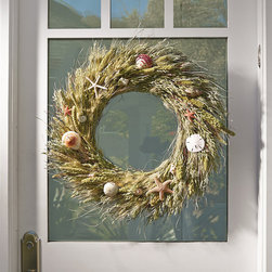 "Frontgate - Ocean's Bounty Coastal Wreath - 22"" dia. - Made with real millet, oats, wheat and seashells. Use indoors or in a covered outdoor space. Choose from two sizes; design changes slightly according to size. Dress your door with visions of sand dunes, seashells and breezy days at the shore. Our exclusive Ocean's Bounty Wreath captures the romance of the ocean, with a sand-colored circle of millet, oats and wheat awash with beautifully colored shells, starfish, sea urchin and sand dollars.  .  .  . Made in USA."