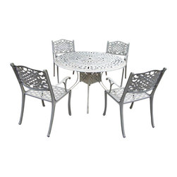 Oakland Living - 5-Pc Outdoor Dinning Set - Includes capital table, four chairs and metal hardware. Traditional lattice pattern with scroll work. Handcast. Hardened powder coat. Fade, chip and crack resistant. Warranty: One year limited. Made from rust free cast aluminum. Beach sand color. Minimal assembly required. Table: 48 in. Dia. x 29 in. H. Chair: 22.5 in. W x 22 in. D x 35 in. H (23 lbs.)The Oakland Mississippi collection combines grace style and modern designs giving you a rich addition to any outdoor setting. We recommend that the products be covered to protect them when not in use. To preserve the beauty and finish of the metal products, we recommend applying an epoxy clear coat once a year. However, because of the nature of iron it will eventually rust when exposed to the elements.