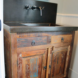 Sinks and Vanities - Integral sink top in stained concrete sits atop a unique distressed vanity cabinet.