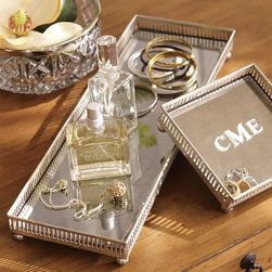 Mirrored Dresser-Top Trays - Mirrored trays have that glamorous feeling of a dressing room from old black and white movies. They're a luxurious place to keep even costume jewelry on display.