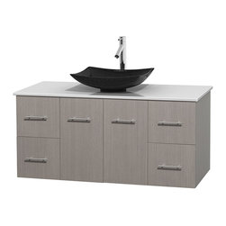 "Wyndham Collection - Centra 48"" Grey Oak Single Vanity, White Man-Made Stone Top, Black Granite Sink - Simplicity and elegance combine in the perfect lines of the Centra vanity by the Wyndham Collection. If cutting-edge contemporary design is your style then the Centra vanity is for you - modern, chic and built to last a lifetime. Available with green glass, pure white man-made stone, ivory marble or white carrera marble counters, with stunning vessel or undermount sink(s) and matching mirror(s). Featuring soft close door hinges, drawer glides, and meticulously finished with brushed chrome hardware. The attention to detail on this beautiful vanity is second to none."