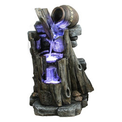 Yosemite Home Decor - Yosemite Home Decor Three-Tiered Steps w/ Vase Polyresin Indoor/Outdoor Fountain - This Yosemite Home Decor indoor/outdoor fountain features a primitive-like design with a large trunk that has been carved out to accommodate the incorporated fountain. Three tiers create a gentle flow of trickling water that is highlighted by an LED light. Polyresin and Lime Green finishing create a surprisingly realistic look.
