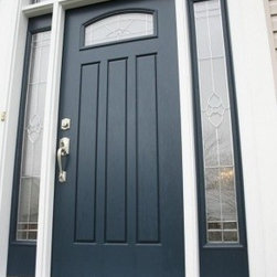 Black Front Door with decorative arch top window - Beautiful entry door installed by Opal Enterprises in Wheaton, IL