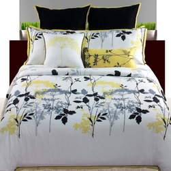 angelo:HOME - Gramercy Park Comforter Set - Here, the Gramercy in a bit more subdued combination yet just as powerful, I think. The comforter is reversible (solid celadon green on one side and the floral pattern on the other) and the mix of patterns will make your bed feel like it went shopping at your favorite boutiques. When we were photographing this collection I kept trying it up against different finishes and styles. It was so versatile. If you have a reading nook in your bedroom, an old worn leather club chair would be the perfect companion to add to this mix. - Angelo Surmelis Features: -Available in Queen or King sizes. -Includes 1 comforter, 1 double sham and 2 decorative pillows. -Color: White / black / yellow. -Material: Polyester. -Fill: Polyester. -Dry clean only.