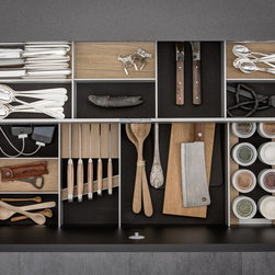 SieMatic Interior Design System - The fundamental principle of the SieMatic interior accessories system begins with the aluminum elements, and Flock2Block, to which elements can added to accommodate a knife block, spice mills and jars, a USB port, and numerous other possibilities that create a personal living space in the kitchen.