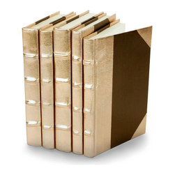 Metallic Collection Books - Rose Gold  - Set of 5 - You can, indeed, judge a book by its cover. A visually striking set of decorative tomes, the Metallic Collection Books - Rose Gold - Set of 5   make an impressive graphic statement when placed upon a shelf in an eclectic great room, a window ledge in a home office, a fireplace mantel embellished with objets d'art, or glass-fronted armoire in a personal library.