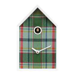 Progetti - Tartan White/Green Wall Clock - Inspired by the typical houses of the United Kingdom, characterized by sloping roofs, flashings and vibrant colors, Tartan is a harmonious, warm and 'at home' cuckoo clock. An object that is well-suited to various types of homes, from the most classical and country to modern. The structure, in white-painted wood, is in the form of a cottage and encloses the 'facade' which is in different shades (blue, red and green) of plaid fabric. Precisely the tartan that with its characteristic design of ancient origins, but always current, recalls the landscapes of the Scottish Highlands as well as the typical kilt. Battery quartz movement. A light sensor automatically turns off the cuckoo sound in the absence of light.