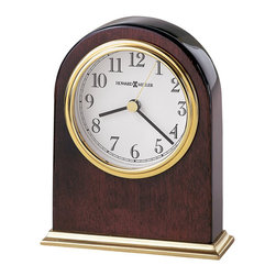 Howard Miller - Howard Miller Monroe Table Top Clock - Howard Miller - Mantel / Table Clocks - 645446 - This contemporary table clock has a radiant character and will be an attractive fixture on any mantel or table top. Distinguished by its polished brass tone dial bezel and base and classic white dial the Monroe has a real gleam to it. Beautiful hardwood framing in a rosewood finish and quality quartz movement operation complete the look and appeal of this accent clock.