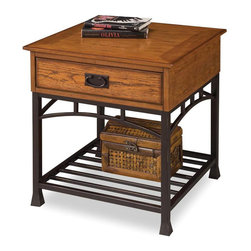 HomeStyles - End Table in Distressed Oak Finish - One storage drawer. Open storage shelf. Brown metal accents. Made from poplar solids and oak veneers. Distressed oak finish. 22 in. W x 22 in. D x 24 in. H. Assembly InstructionsReminiscent of the American craftsman era with understated style and simplicity, the modern craftsman entertainment collection marries a traditional.