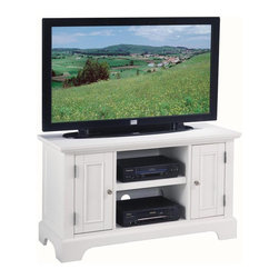HomeStyles - Naples TV Stand - Casual style. Two cabinets each with an adjustable shelf. Center fixed shelf. Open center storage compartment with adjustable shelf accommodates electronic components. Convenient wire management openings. Perfect for 46 in. flat screen TVs. Made from Asian solid hardwoods and engineered wood. Rich white finish. Made in Thailand. 44 in. W x 18 in. D x 26 in. H. Assembly InstructionsThe Naples entertainment stand is a excellent addition to a home with its charming cottage decor. Clear coat finish to help guard against wear and tear stemming from normal use.