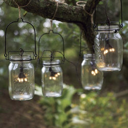 Glass Mason Jar Solar String Lights - There's something magical about lights twinkling in the canopy of the trees in the evening. These are great for entertaining or a quiet romantic evening with someone special.