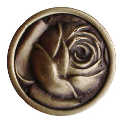 "Notting Hill - Notting Hill McKenna's Rose Knob - Antique Brass - Notting Hill Decorative Hardware creates distinctive, high-end decorative cabinet hardware. Our cabinet knobs and handles are hand-cast of solid fine pewter and bronze with a variety of finishes. Notting Hill's decorative kitchen hardware features classic designs with exceptional detail and craftsmanship. Our collections offer decorative knobs, pulls, bin pulls, hinge plates, cabinet backplates, and appliance pulls. Dimensions: 1-5/16"" diameter"