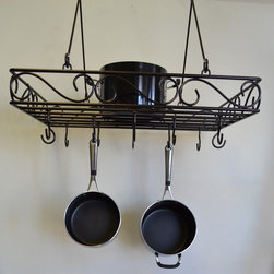J & J Wire - J & J Wire Scrolled Wrought Iron Pot Rack - BR878 - Shop for Pot Racks from Hayneedle.com! Get your fancy collection of treasured pots and pans out of the cupboard and put them on display on the J & J Wire Scrolled Wrought Iron Pot Rack. Proudly made in the USA by skilled craftsman from wrought iron this pot rack has an elegant scrolled design and is available in dark pewter or bronze powder-coat finish. It includes twelve hooks which are welded in place for stability and are perfectly spaced to give you multiple options in hanging your cookware. About J & J Wire Inc.Located at the Industrial Park in Beatrice Nebraska J & J Wire Inc. started 25 years ago as a wire-forming business manufacturing mostly houseware items. Since then the company has grown into a metal fabrication business serving customers in many different manufacturing sectors in the United States and Canada. From quilt racks to wine racks J & J Wire is committed to creating handmade works of art at affordable prices.