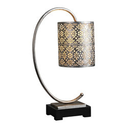 "Uttermost - Contemporary Uttermost Faleria Metal Table Lamp - This table lamp offers a unique design. The curved 'C' base elegantly complements the floral details that wrap around the round drum shade. The piece also features antique silver leaf and matte black foot.  Contemporary table lamp. Stamped metal construction. Light antique silver leaf finish. Floral details. Round drum shade. On-off switch On-line switch. Maximum 100 watt bulb (not included). 24"" high. Lamp shade measures 8"" wide.  Stamped metal construction.  Light antique silver leaf finish.  Floral details.  Round drum shade.  On-off switch On-line switch.  Maximum 100 watt bulb (not included).  24"" high.  Lamp shade measures 8"" wide."