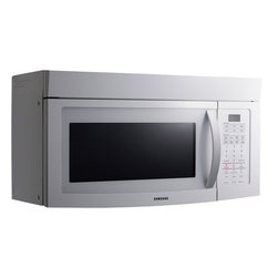 Samsung - Over the Range Microwave Oven - Description • Features • Specifications • Warranty  Description Samsungs SMH1713B 1.7 Cu. Ft. Over the Range Microwave Oven, in black, makes it easy to achieve superior cooking results. Automatic defrost takes the guesswork out of defrosting and guarantees accuracy. The auto defrost feature considers the weight of the food being cook and adjusts the time accordingly. With two-stage programmable cooking allows you to defrost food and program a 2 step recipe simultaneously, which make for more efficient food preparation. Back To Top Features -1.7 cu. ft. Over the range microwave oven with rotating glass turn table. -Two-stage programmable cooking. -4 One touch instant cook options. -10 Power levels including defrost and 12 sensor cook options. -Auto cook modes include: 4 kids meals, 4 snack options, and 4 soften / melt options. -3 Defrost Features: 1 lbs. defrost, auto defrost, and custom cook. -Features a timer and a reminder end signal. -Vent fan control: high, low, off. -Charcoal / grease vent filters; Digital cooking timer, up to 99 minutes and 99 seconds. -Package Contents: microwave, turntable, turntable support, grease filters, charcoal filter, hardware kit, registration card, warranty, manual. Back To Top Specifications Product Specifications   UPC:  036725560406, 036725560420, 036725560413   Product Type:  Microwave Oven   Size:  1.7 Cu. Ft.   Finishes:  Black, Stainless Steel, White  General Specifications  Auto Defrost:  Yes   Charcoal Vent Filter:  Yes   Cooking Stages:  Two Stage Programmable Cooking   Cooktop Lighting:  Yes